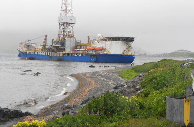 In this Saturday, July 14, 2012 photo provided by Capt. Kristjan B. Laxfoss, a Shell drilling ship drifts near shore near Dutch Harbor on Unalaska Island, Alaska. The Coast Guard says an inspection of the Shell drilling ship that lost its mooring and drifted toward shore of an Alaska Island shows no signs of damage or grounding.