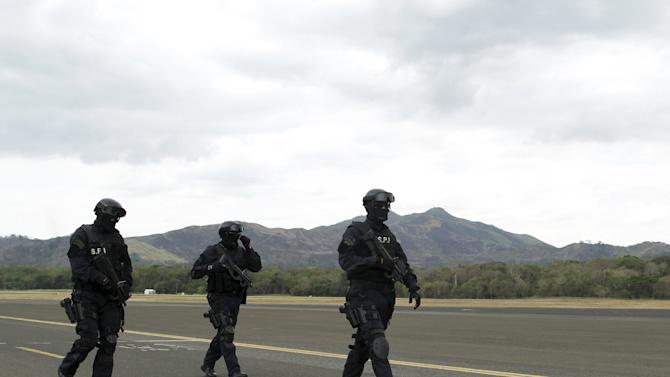 Members of the Police Special forces Unit take part in a security exercise, to prepare for the upcoming 7th Summit of the Americas, at the Panama Pacific airport in Panama City