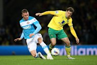 Norwich City's Grant Holt (right) and Sunderland's Connor Wickham battle for the ball during their English Premier League match at Carrow Road, Norwich. Monday Sept. 26, 2011. (AP Photo / Chris Radburn/PA) UNITED KINGDOM OUT NO SALES NO ARCHIVE