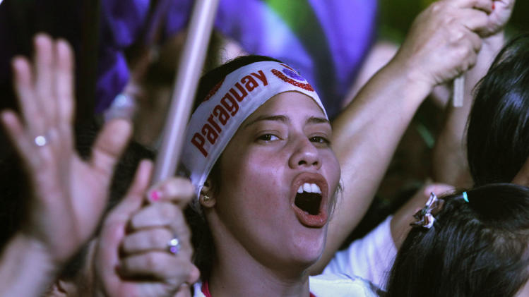 Supporters of Efrain Alegre, presidential candidate of Paraguay's Liberal Party, cheer at his campaign rally in Asuncion, Paraguay, Thursday, April 18, 2013. Paraguay hold general elections on Sunday, April 21. (AP Photo/Jorge Saenz)