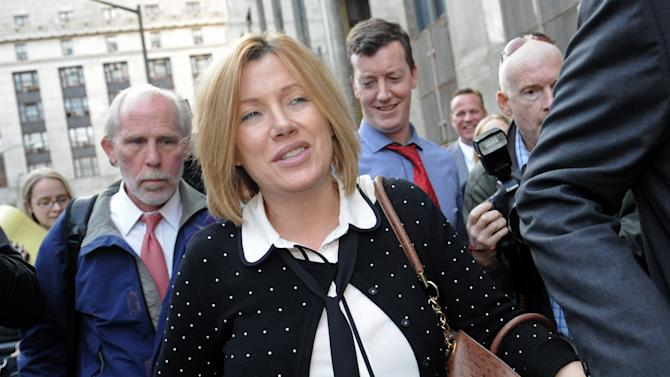 FILE - In this Sept. 25, 2012, file photo, Anna Gristina exits Manhattan criminal court in New York. The suburban mother of four charged with moonlighting as a multimillion-dollar madam pleaded guilty in September to promoting prostitution and is scheduled for sentencing on Tuesday, Nov. 20, 2012. (AP Photo/Louis Lanzano, File)