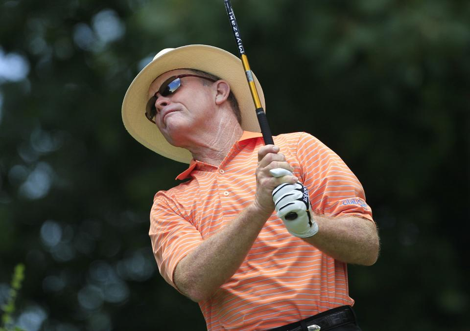 Tom Kite watches his drive on the second hole during the third round at the U.S. Senior Open golf tournament at the Indianwood Golf and Country Club in Lake Orion, Mich., Saturday, July 14, 2012. (AP Photo/Carlos Osorio)