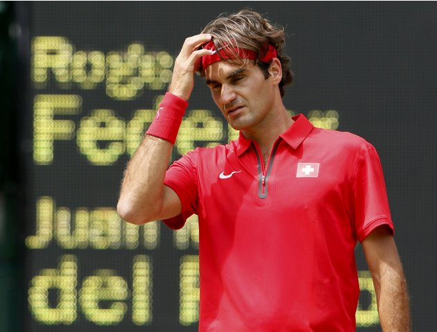Switzerland's Federer reacts during his men's singles tennis semi-final match against Argentina's del Potro at the All England Lawn Tennis Club during the London 2012 Olympic Games