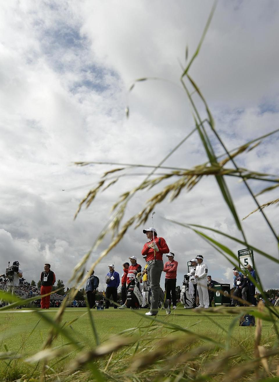 Rory McIlroy of Northern Ireland watches  his shot off the fifth tee at Royal Lytham & St Annes golf club during the second round of the British Open Golf Championship, Lytham St Annes, England, Friday, July 20, 2012. (AP Photo/Jon Super)