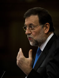 Spain's conservative leader and country's next prime minister Mariano Rajoy speaks at the Parliament a month after being elected, in Madrid, Tuesday, Dec. 20, 2011. Spain's Parliament was to vote conservative Popular Party leader Mariano Rajoy as premier later Tuesday. Spain's borrowing costs have plummeted in a short-term debt auction, indicating market confidence in the country's ability to handle its debt is recovering. (AP Photo/Daniel Ochoa de Olza)