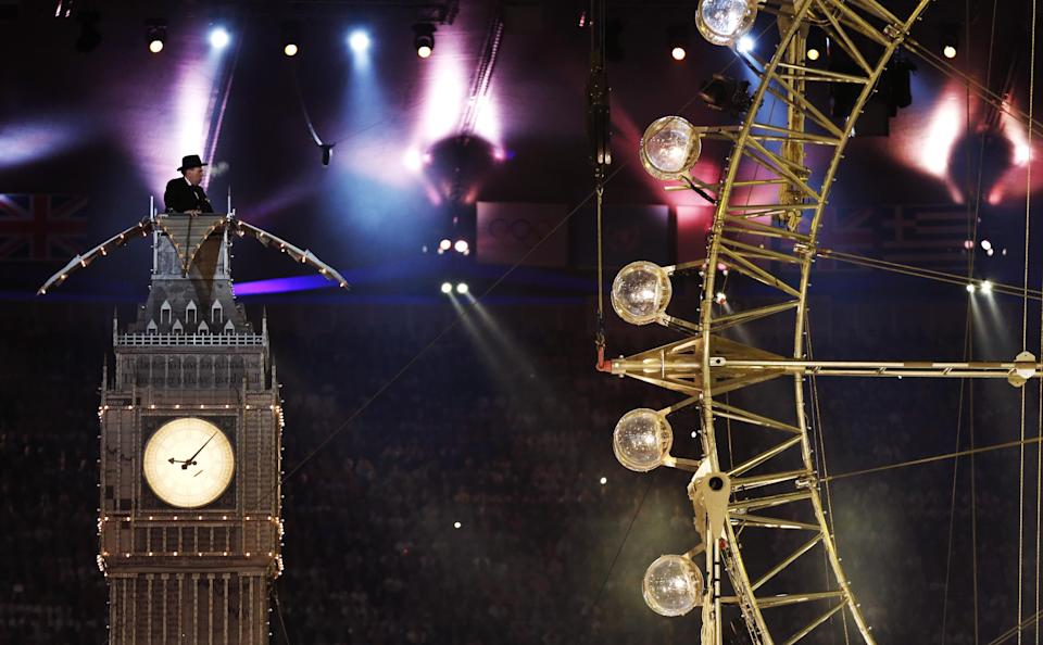 Actor Timothy Spall portrays Winston Churchill as he delivers a speech from atop a representation of St. Stephens' Tower during the Closing Ceremony at the 2012 Summer Olympics, Sunday, Aug. 12, 2012, in London. (AP Photo/Matt Dunham)