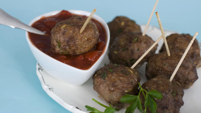 n this image taken on Monday, Nov. 26, 2012, cocktail meatballs with cranberry marinara are shown served on a platter in Concord, N.H. (AP Photo/Matthew Mead)