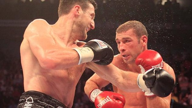 Carl Froch does battle with Lucian Bute en route to a third world title (Lawrence Lustig)