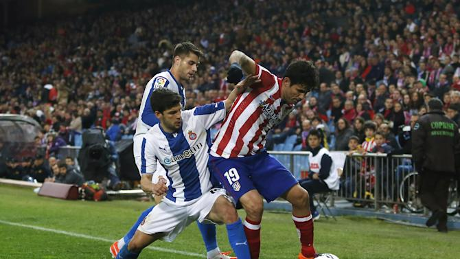 Atletico's Diego Costa, right, vies for the ball with Espanyol's Javi Lopez center, during a Spanish La Liga soccer match between Atletico Madrid and Espanyol at the Vicente Calderon stadium in Madrid, Spain, Saturday, March 15, 2014