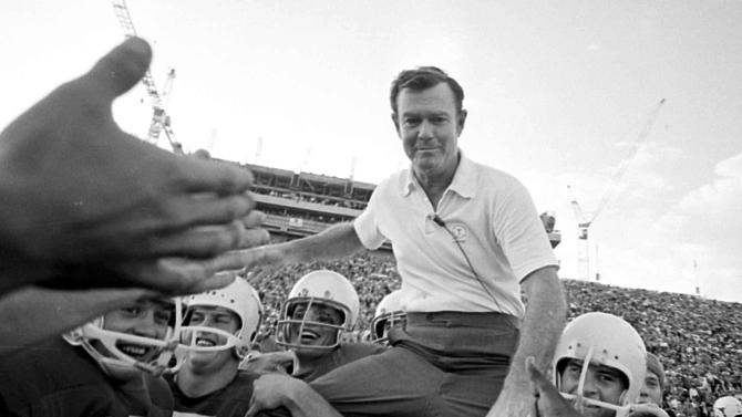 FILE - In this Dec. 5, 1970, file phot, Texas coach Darrell Royal is carried from the field on the shoulders of his Longhorns following Texas' 42-7 triumph over Arkansas in Austin, Texas. Royal, who won two national championships and turned the Longhorns program into a national power, died early Wednesday, Nov. 7, 2012, at age 88 of complications from cardiovascular disease, school spokesman Bill Little said. Royal also had suffered from Alzheimer's disease.   (AP Photo/File)