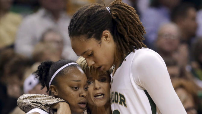 FILE - In this Dec. 18, 2012, file photo, Baylor head coach Kim Mulkey, center, hugs Brittney Griner (42) and Odyssey Sims (0) after the players were pulled late in the second half of their NCAA college basketball game against Tennessee in Waco, Texas. Baylor was announced Monday, March 18, 2013, to join Connecticut, Stanford and Notre Dame as a No. 1 seed in the women's tournament, marking the second straight season those four schools were the top seeds. (AP Photo/LM Otero, File)