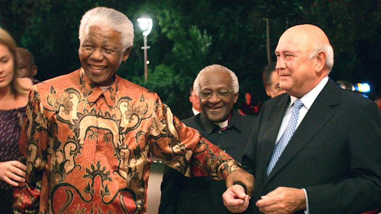 FILE - In this Friday, March 17 file photo former South African presidents Nelson Mandela, left, and FW de Klerk, right, with Anglican Archbishop Desmond Tutu, center, at de Klerk's 70th birthday party in Cape Town, South Africa. A new documentary film to be released, focuses on de Klerk who was the country's last white president and who, together with Mandela, plotted the historic transition to a multi-racial democracy, for which they were jointly awarded the Nobel Peace Prize in 1993 (AP Photo/Obed Zilwa-File)