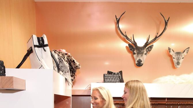 COMMERCIAL IMAGE - In this photograph taken by AP Images for HUSET, Holly Hallberg, left, and a guest are seen at the HUSET store opening, on Thursday, Sept. 22, 2011, in Venice, Calif.  (Casey Rodgers/AP Images for HUSET)