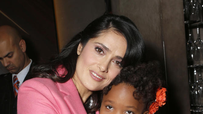 Salma Hayek and Quvenzhane Wallis attend the Film Independent Spirit Awards Luncheon at BOA Steakhouse on Saturday, Jan. 12, 2013, in West Hollywood, Calif. (Photo by Todd Williamson/Invision/AP)