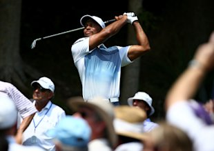 Tiger Woods drew a big crowd during his practice round. (Getty Images)
