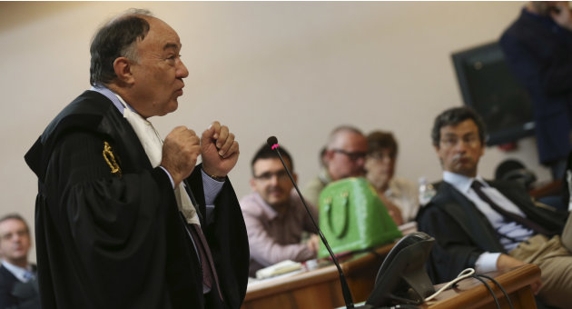 Ennio Amodio, defence attorney of the former Finmeccanica CEO Giuseppe Orsi, speaks at the opening of a corruption trial against Finmeccanica, at the Busto Arsizio court, northern Italy, Wednesday, Ju