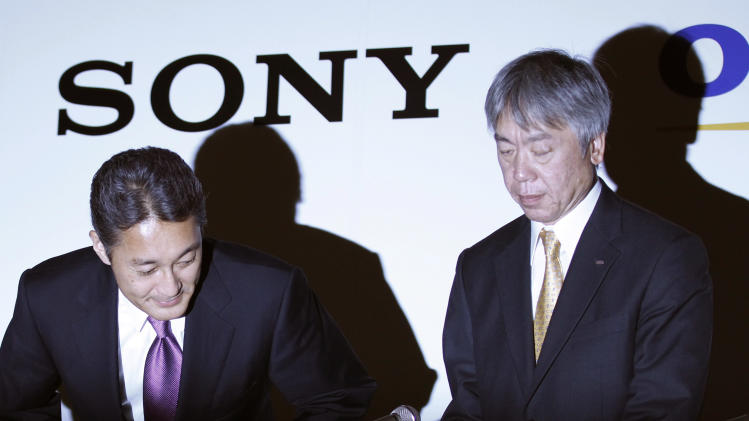 Sony Corp. President and Chief Executive Officer Kazuo Hirai, left, and Olympus Corp. President Hiroyuki Sasa take seats at the start of a joint press conference on their business deal in Tokyo Monday, Oct. 1, 2012. Japan Sony's new alliance with scandal-tarnished Olympus will produce endoscopes and other surgical tools packed with the Japanese electronics and entertainment maker's three-dimensional imagery and super-clear display technology called 4K. (AP Photo/Koji Sasahara)