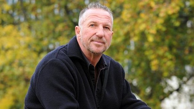 Sir Ian Botham is to walk 160km for charity (PA)