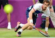 Andy Murray of Britain returns the ball against Stanistas Wawrinka of Switzerland during their men&#39;s singles tennis match at the 2012 London Olympic Games at the All England Tennis Club in Wimbledon, southwest London. The Scot beat Swiss flag-bearer 6-3, 6-3