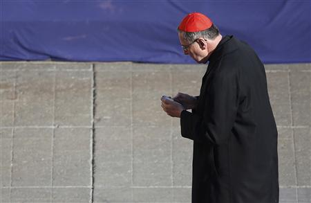 Cardinal Roger Mahony of the U.S. attends the last general audience of Pope Benedict XVI in St Peter's Square at the Vatican