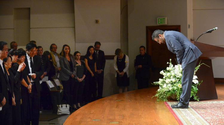 Handout photo shows Soni, USC Dean of Religious Life, bowing to the family during a memorial service for Xinran Ji, in Los Angeles, California.