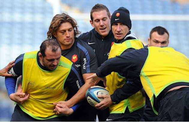 (L-R) France's rugby union national team prop David Attoub, prop Dimitri Szarzewski, flanker Imanol Harinordoquy and assistant coach Patrick Lagisquet take part in a training session on February 25, 2
