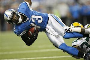 Detroit Lions wide receiver Nate Burleson is tackled by Green Bay Packers defensive back Sam Shields in Detroit