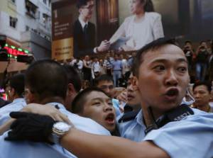 Pro-democracy protester bleeds in the month as he is…
