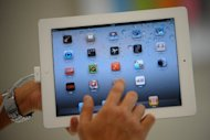 A Chinese computer company which sued Apple over the rights to the iPad trademark in China is now in talks for an out-of-court settlement, a lawyer for the firm said Monday