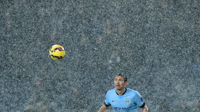 Manchester City's Frank Lampard watches the ball through a snow shower during an English Premier League match against West Bromwich Albion at The Hawthorns on December 26, 2014