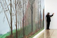 David Hockney at an earlier London exhibition of his work. Britain's greatest living artist, David Hockney, has swapped the Californian sunshine for the landscape of his native Yorkshire for a blockbuster exhibition which goes on show this week