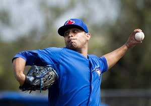 Toronto Blue Jays starting pitcher Ricky Romero pitches against the Minnesota Twins during first inning MLB Grapefruit League baseball action Dunedin, Fla., on Tuesday, Feb. 26, 2013. As spring training starts go, it was a big one for Romero.Romero, who has gone from No. 1 in the rotation last year to No. 5 in a revamped starting five, has struggled in spring training and needed to step up in his Grapefruit League start against Pittsburgh on Tuesday. THE CANADIAN PRESS/Nathan Denette