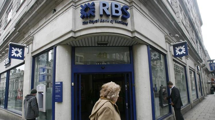 Pedestrian walks past a branch of the Royal Bank of Scotland in central London