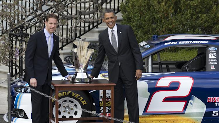President Barack Obama and NASCAR driver Brad Keselowski pose with Keselowski's trophy in front of his car during  ceremony to honor the winner of the NASCAR Sprint Cup Series championship, Tuesday, April 16, 2013, on the South Lawn of the White House in Washington. (AP Photo/Manuel Balce Ceneta)