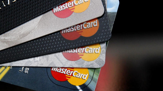 FILE - In this Thursday, April 25, 2013, file photo, MasterCard credit cards are displayed for a photographer in Montpelier, Vt. MasterCard Inc. reports quarterly financial results before the market opens on Friday, Jan. 31, 2014. (AP Photo/Toby Talbot)
