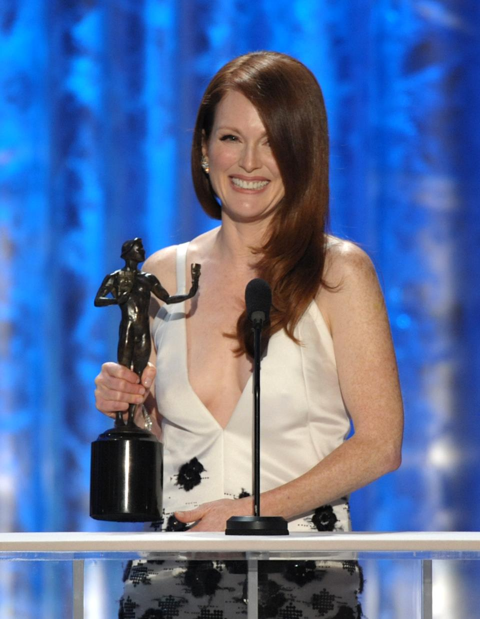 "Julianne Moore accepts the award for outstanding female actor in a TV movie or miniseries for ""Game Change"" at the 19th Annual Screen Actors Guild Awards at the Shrine Auditorium in Los Angeles on Sunday, Jan. 27, 2013. (Photo by John Shearer/Invision/AP)"