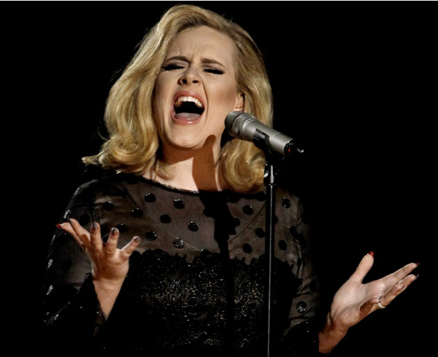"FILE - In this Feb. 12, 2012 file photo, Adele performs during the 54th annual Grammy Awards in Los Angeles. The British singer's ""21"" was the highest-selling album in the U.S. for the second consecut"