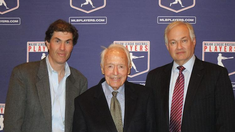 In this April 24, 2012 photo provided by the Major League Baseball Players Association, Michael Weiner, left, MLBPA executive director; Marvin Miller, center, former head of the association; and Donald Fehr, former MLBPA executive director and currently the executive director of the NHL Players' Association, gather for a photo at New York University School of Law in New York, where Miller discussed the 40th anniversary of the first baseball strike. Miller, the union leader who created free agency for baseball players and revolutionized professional sports with multimillion dollar contracts, died Tuesday, Nov. 27, 2012 in New York. He was 95. (AP Photo/MLBPA, Ashton Ramsburg, File)