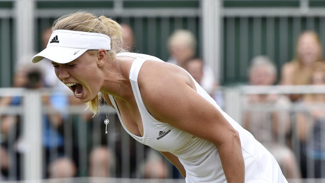 Caroline Wozniacki of Denmark celebrates after winning her match against Denisa Allertova of the Czech Republic at the Wimbledon Tennis Championships in London
