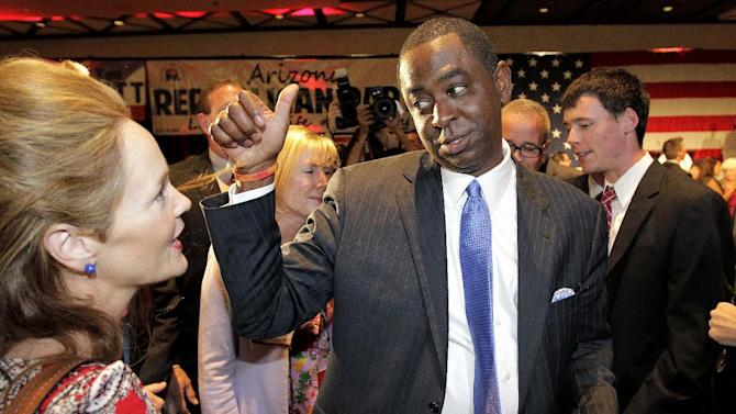 FILE - In a Tuesday, Nov. 6, 2012 file photo, Republican congressional candidate Vernon Parker greets the crowd during an election night party, at a hotel in Phoenix. Parker was defeated by democratic challenger Krysten Sinema for Arizona's ninth congressional district. (AP Photo/Matt York, File)