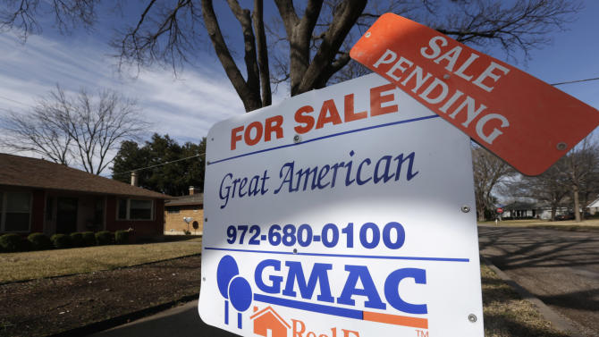 In this Friday, Feb. 22, 2013, photo, a sale pending announcement sits atop a for sale sign in a home's yard in Richardson, Texas.  Fewer Americans signed contracts to buy homes in February, but the level stayed close to a nearly three-year high. The report suggests sales of previously occupied homes will keep rising in the coming months.  (AP Photo/LM Otero)