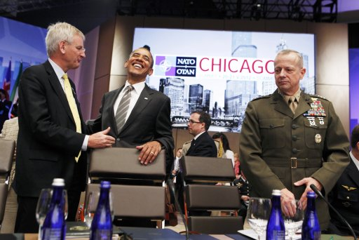 U.S. President Barack Obama laughs as he arrives at the Afghanistan meeting at the 2012 NATO Summit in Chicago