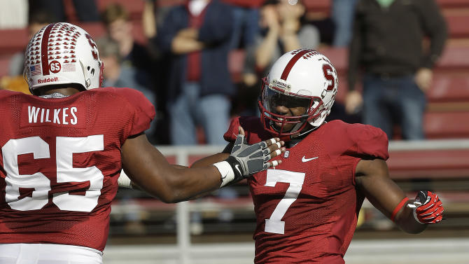 Stanford wide receiver Ty Montgomery (7) celebrates with teammate Khalil Wilkes (65) after scoring a touchdown against California during the first half of an NCAA college football game in Stanford, Calif., Saturday, Nov. 23, 2013. (AP Photo/Tony Avelar)