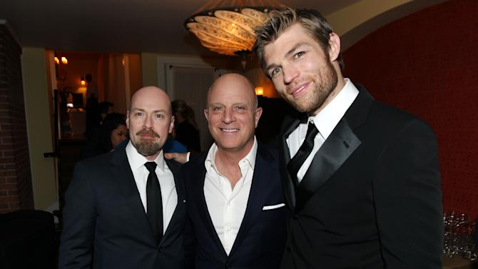 """IMAGE DISTRIBUTED FOR STARZ -Creator Steven S. DeKnight, left, Chris Albrecht, chief executive of STARZ, center, and Liam McIntyre pose together at the after party for the premiere of """"Spartacus: War of the Damned"""" on Tuesday, Jan. 22, 2013 in Los Angeles. """"Spartacus: War of the Damned"""" premieres Friday, Jan. 25 at 9PM on STARZ. (Photo by Matt Sayles/Invision for STARZ/AP Images)"""