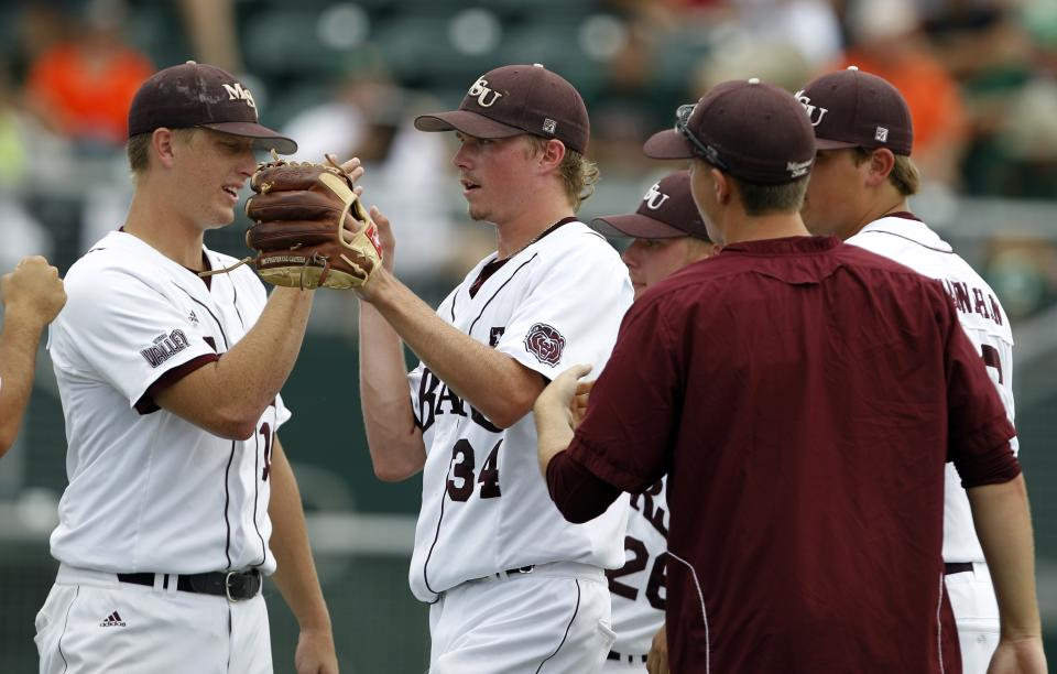 Missouri State starting pitcher Pierce Johnson (34) is met by Danny McMurtrey, left, after pitching in the second inning during an NCAA college baseball tournament regional game against Miami, Saturday, June 2, 2012, in Coral Gables, Fla. (AP Photo/Lynne Sladky)