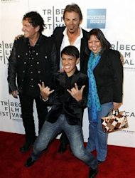 "Singer Arnel Pineda (bottom C), Neal Schon (L), and Jonathan Cain of the band Journey arrive with director Ramona Diaz (R) for the premiere of ""Don't Stop Believin': Everyman's Journey"" during the 2012 Tribeca Film Festival in New York, April 19, 2012. REUTERS/Lucas Jackson"
