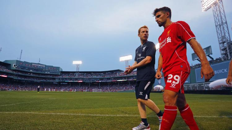 Liverpool's Fabio Borini leaves the field after being injured during friendly soccer match against AS Roma at Fenway Park in Boston