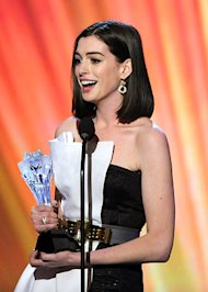 Actress Anne Hathaway accepts the Best Actress award