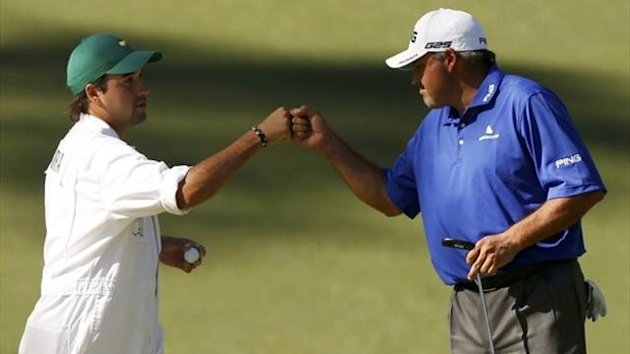 Angel Cabrera is congratulated by his caddie, Angel Jr