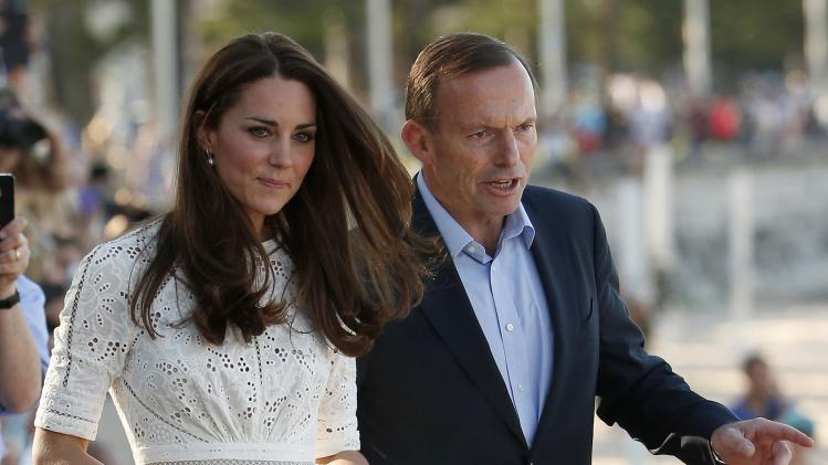 Catherine, Britain's Duchess of Cambridge, arrives with Australian Prime Minister Tony Abbott at Manly beach in Sydney